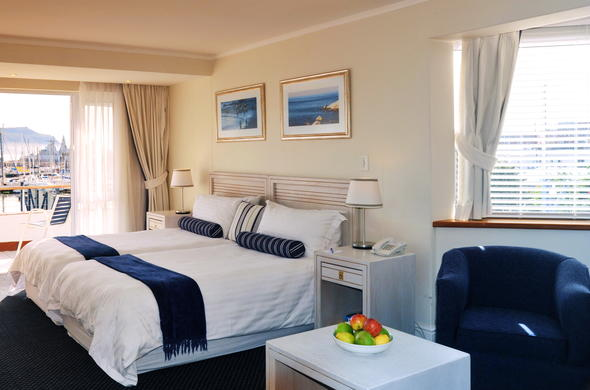 Double bedroom with balcony at Simon's Town Quayside Hotel.
